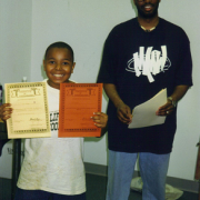 Boy with certificates